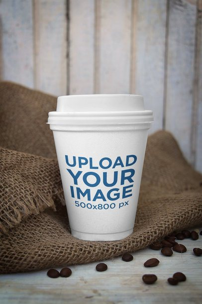 Mockup of a Paper Cup Featuring a Jute Sack and Coffee Beans 3758-el1