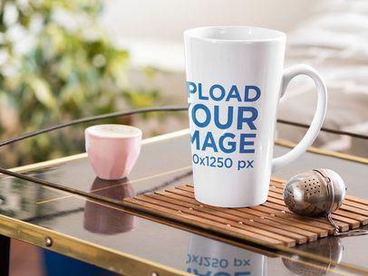 Mockup of a Conical 15 oz Coffee Mug Next to a Tea Infuser 33667