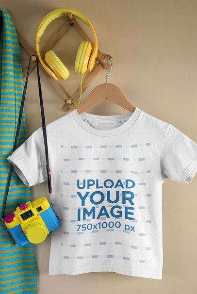 Mockup of a Kid's T-Shirt Featuring a Toy Camera and Headphones 33738