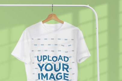 Mockup of a T-Shirt Hanging Near a Window and Featuring a Customizable Background 3727-el1