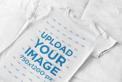 Flat Lay T-Shirt Mockup Against a Mattress Sheet 33941