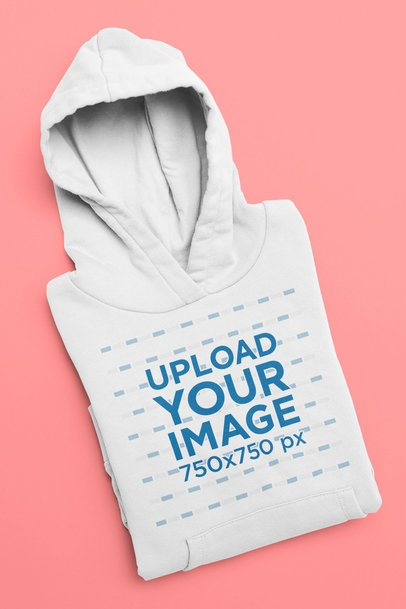 Mockup of a Folded Pullover Hoodie Against a Flat Surface 33895