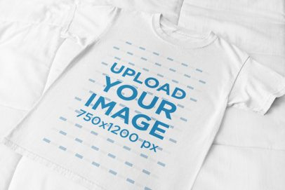Flat Lay T-Shirt Mockup Placed over a Cotton-Fabric Surface 33944