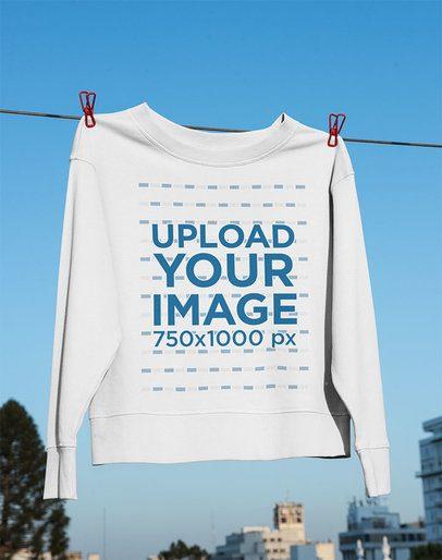 Mockup of a Crewneck Sweatshirt Hanging on a Clothesline 33990