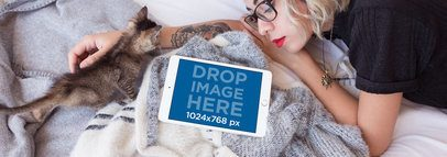 iPad Mockup in Landscape Position of a Woman Lying with a Kitten in Her Bed 12792wide