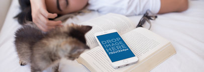 Mockup of an iPhone Over a Book Featuring a Woman Sleeping 12800wide