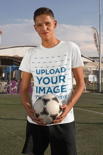 T-Shirt Mockup of a Teenage Boy Holding a Soccer Ball 33554