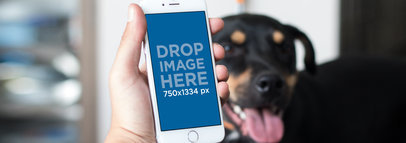 White iPhone 7 Mockup of a Man at Home with his Dog a12790wide