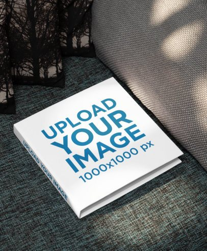 Mockup of a Hardcover Book Placed on a Couch 33913