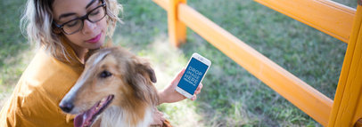 iPhone 7 Mockup of a Lovely Girl with her Dog by an Outdoor Fence a12795wide