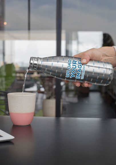 Mockup of Someone Pouring Water From an Aluminum Bottle 33532