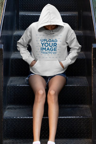 Hoodie Mockup of a Young Woman Sitting on Some Steps 33744