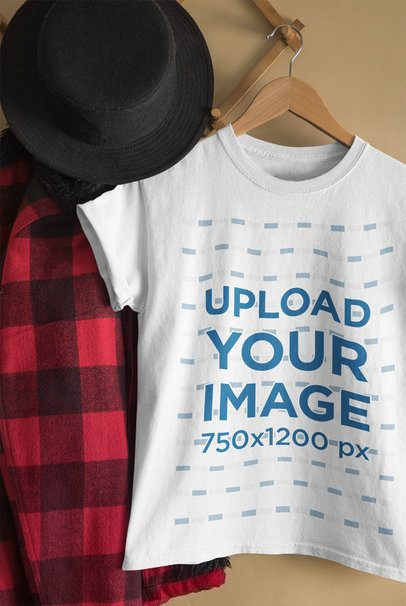 Mockup of a Woman's T-Shirt Hanging Next to a Flannel Garment 33737