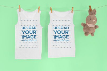 Mockup of Two Tank Tops Hanging Next to a Stuffed Animal 33957