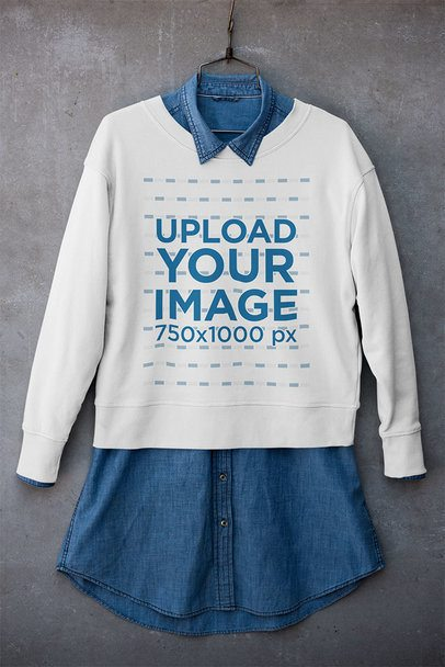 Mockup of a Crewneck Sweatshirt Placed on a Hanger with a Denim Garment 33981