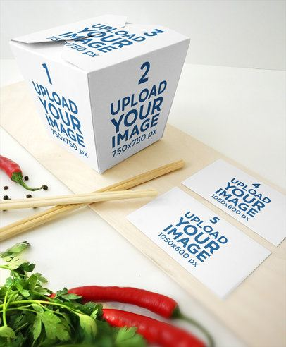 Mockup Featuring a Food Box Placed Next to Two Business Cards 3995-el1