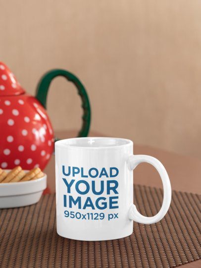 11 oz Coffee Mug Mockup Featuring Some Cookies and a Decorated Teapot 33821