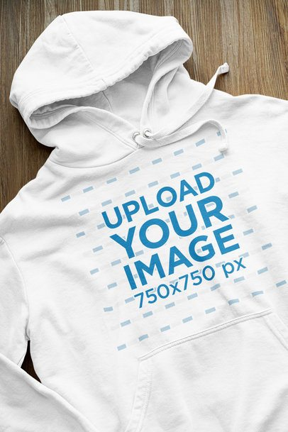 Closeup Mockup of a Pullover Hoodie Against a Wooden Surface 33879
