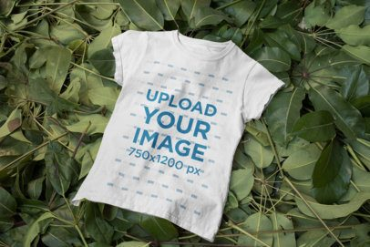 Mockup of a Women's T-Shirt Placed on a Bunch of Plants 33856