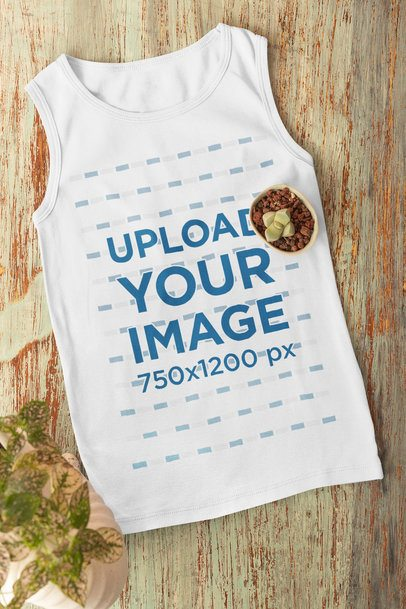 Flat Lay Mockup of a Tank Top Featuring a Small Plant 33963