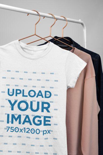Mockup of a Basic T-Shirt Hanging on a Clothing Rack 34003