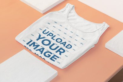Mockup of a Folded Tank Top Laid Flat on a Surface 33968