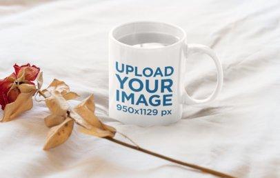 Mockup of an 11 oz Coffee Mug Next to a Dried Rose 33918