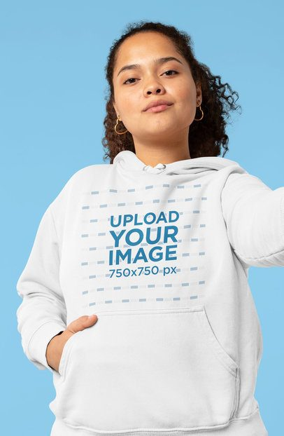 Mockup of a Serious Young Woman with a Hoodie Taking a Selfie 32000