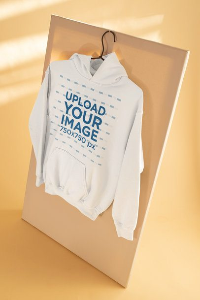 Mockup of a Pullover Hoodie Hanging in a Simple Setting 33762