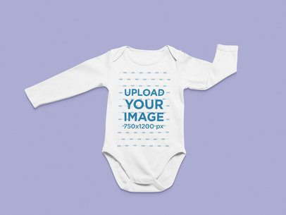 Flat Lay Mockup of a Long Sleeve Onesie in a Minimalist Setting 25325
