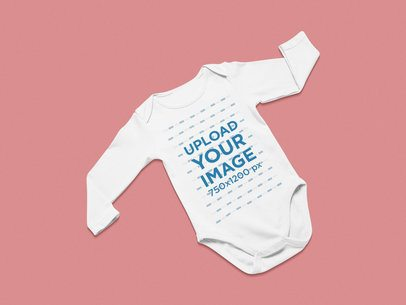 Mockup of a Long Sleeve Onesie Against a Solid Surface 25326