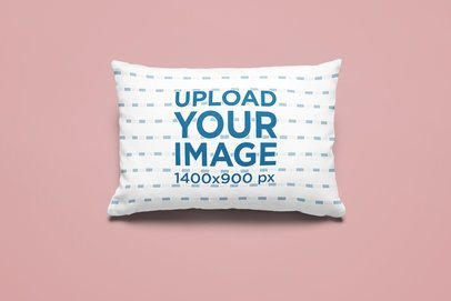 Mockup of a Customizable Rectangular Pillow Placed on a Colored Surface 25527