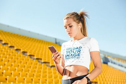 Crop Top Mockup of a Young Woman Checking Her phone at a Stadium 34037-r-el2