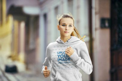 Pullover Hoodie Mockup of a Woman Jogging by a Street 34079-r-el2