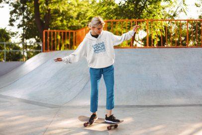 Pullover Hoodie Mockup of a Woman Skateboarding 34109-r-el2