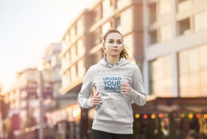 Mockup of a Woman Wearing a Heathered Hoodie While Jogging 34105-r-el2