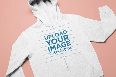 Full-Zip Hoodie Mockup Flat Laid on a Customizable Surface 25622