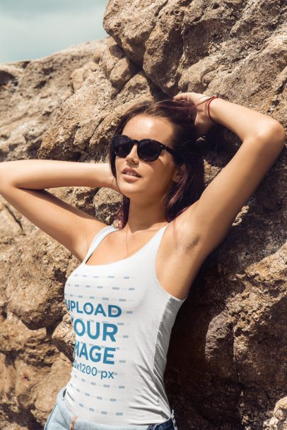 Tank Top Mockup of a Woman with Sunglasses Posing by a Breakwater Rock 34224-r-el2