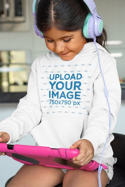 Mockup of a Little Girl with Headphones Wearing a Pullover Hoodie 33887