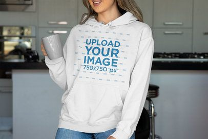 Mockup of a Smiling Woman in a Kitchen Wearing a Pullover Hoodie 33883