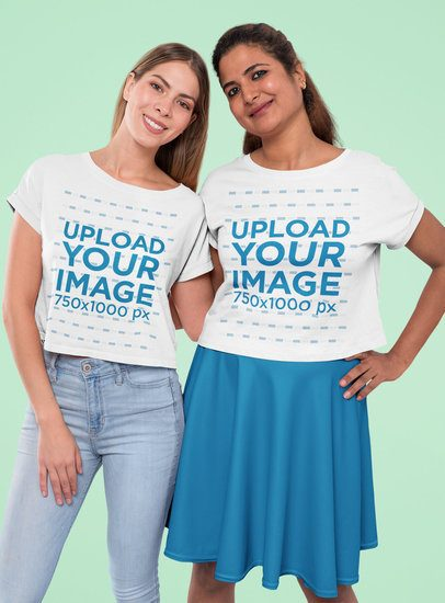Mockup of Two Best Friends Wearing Crop Top Tees at a Studio 31966