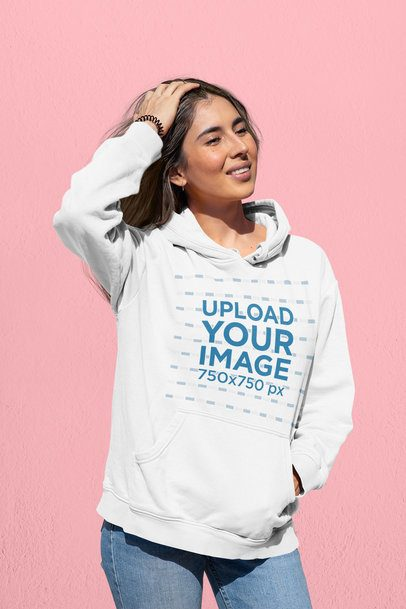 Hoodie Mockup of a Woman at a Studio Touching her Head 33885