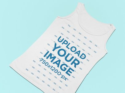 Mockup of a Flat Laid Tank Top Against a Solid Surface 25577
