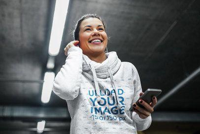Hoodie Mockup of a Jogging Woman Putting on Her Headphones 34153-r-el2