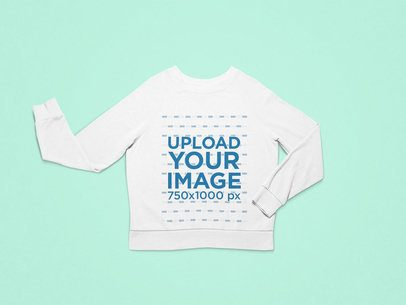 Mockup of Round Neck Sweatshirt Facing Front on a Solid Surface 25727