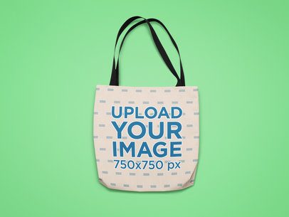 Mockup of a Sublimated Tote Bag Against a Customizable Surface 25525
