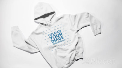 Stop Motion Video of Pullover Hoodies Being Tossed Into a Pile 13275