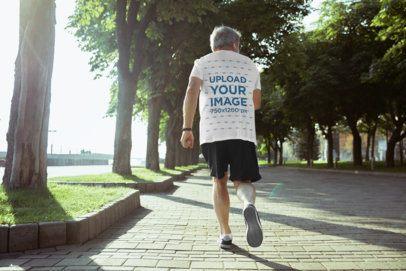 T-Shirt Mockup of a Senior Man Jogging in the Park 34387-r-el2