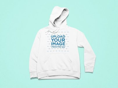 Front-View Mockup of a Hoodie Placed in a Minimalist Setting 25496