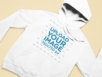 Mockup of a Pullover Hoodie Flat Laid on a Colorful Surface 25647